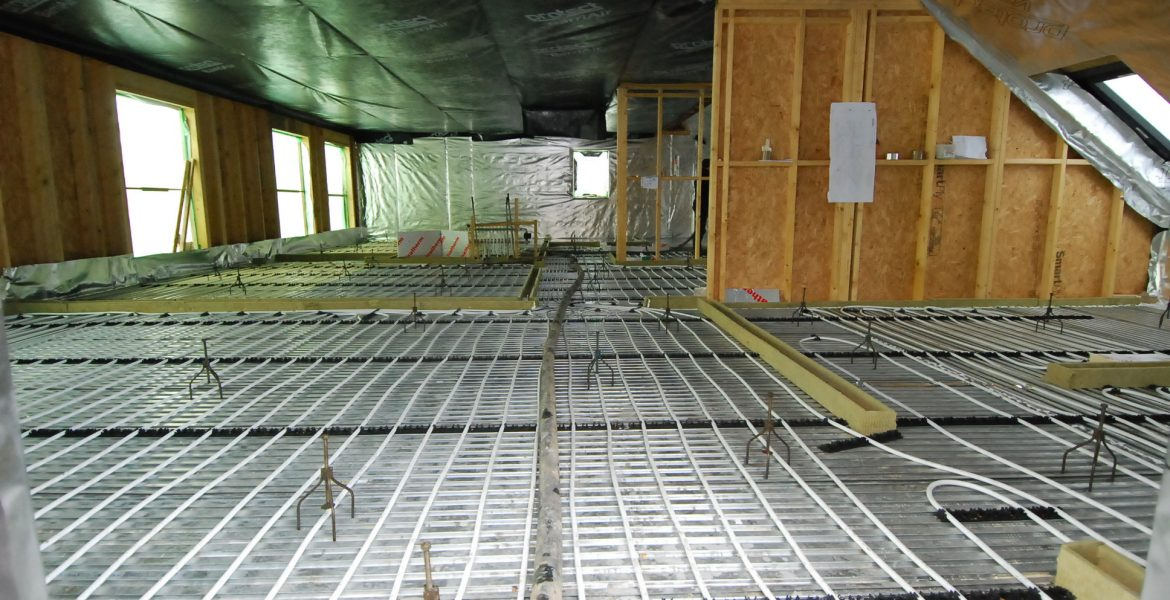 Lewis Plate Underfloor heating metal decking to a timber frame house in Scotland