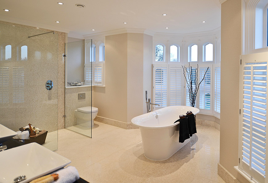 Large format marble tiles in a wet-room bathroom with underfloor heating upstairs on Lewis Deck