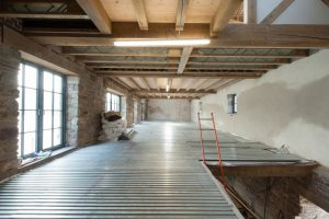 Various timber floor structures at Insworke Mill including exposed timber ceilings