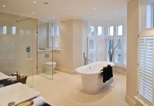 Lewis Deck wet-room floors with underfloor heating and large sheets of marble over timber joists.