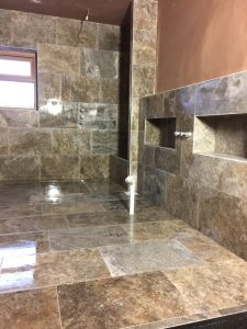 Travertine tiles within a Lewis Deck wet-room with concrete
