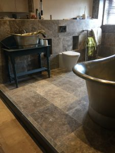 Lewis Deck wet-room floor with Tavertine Tiles