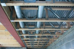 Metal web, timber joists with services installed