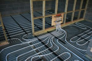 Underfloor heating and manifold over Lewis Deck ready for the screed to be poured