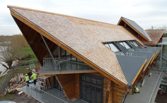 Lacomet flashing being used with ceder shingles on a gold clubhouse roof